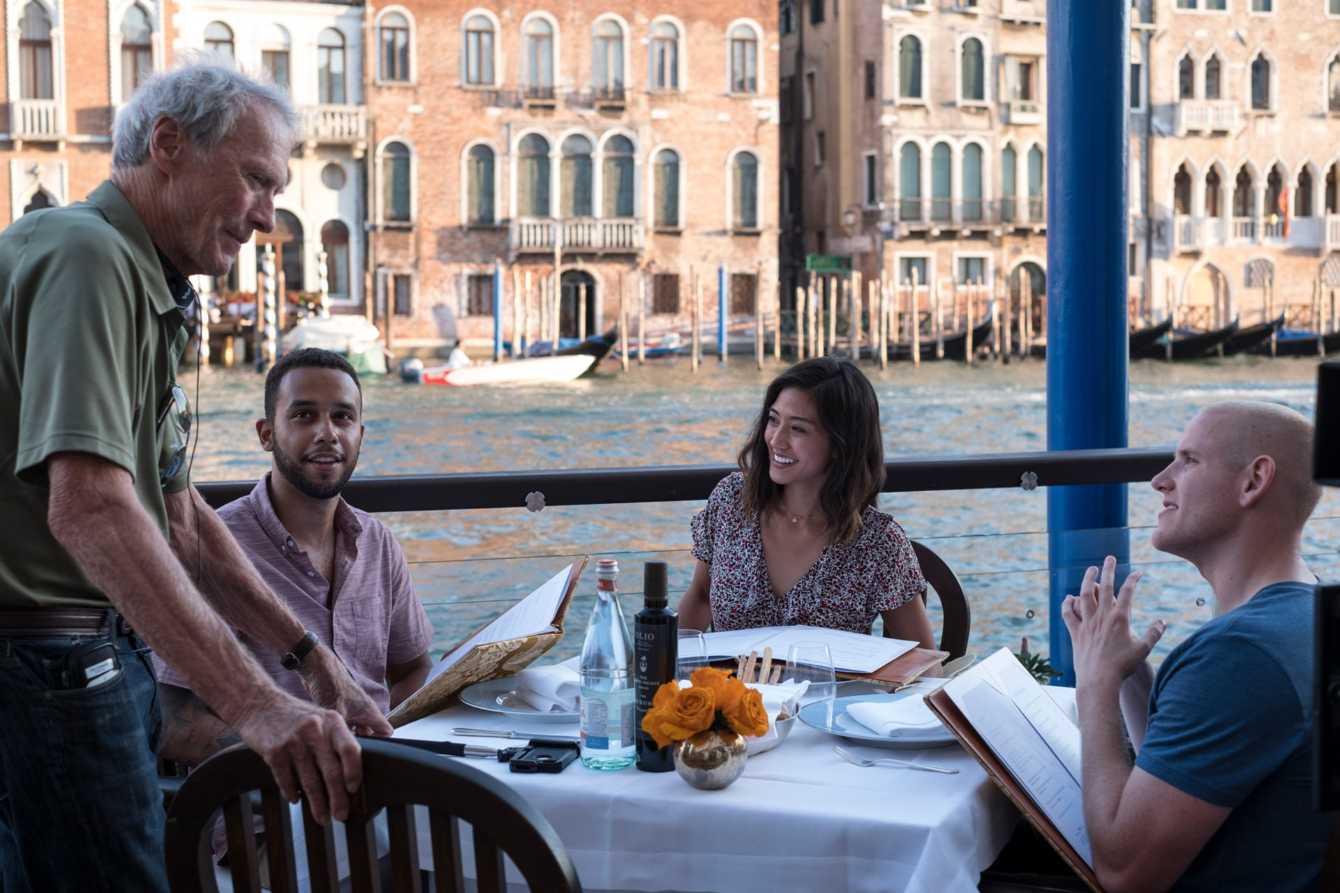 """(L-R) Director/producer CLINT EASTWOOD, ANTHONY SADLER, ALISA ALLAPACH and SPENCER STONE and on the set of Warner Bros. Pictures' and Village Roadshow Pictures' """"THE 15:17 TO PARIS,"""" a Warner Bros. Pictures release."""