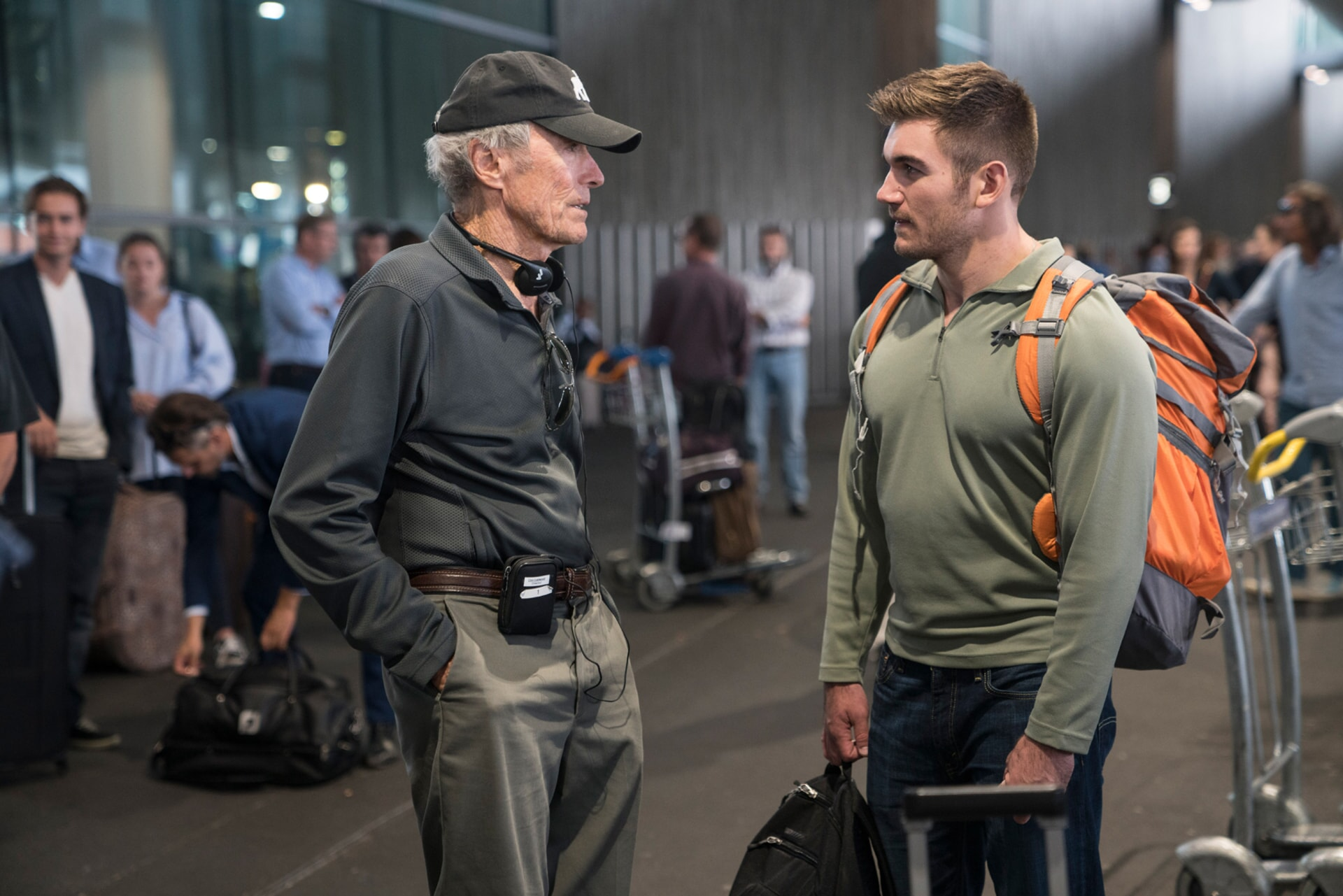 """(L-R) Director/producer CLINT EASTWOOD and ALEK SKARLATOS on the set of Warner Bros. Pictures' and Village Roadshow Pictures' """"THE 15:17 TO PARIS,"""" a Warner Bros. Pictures release."""