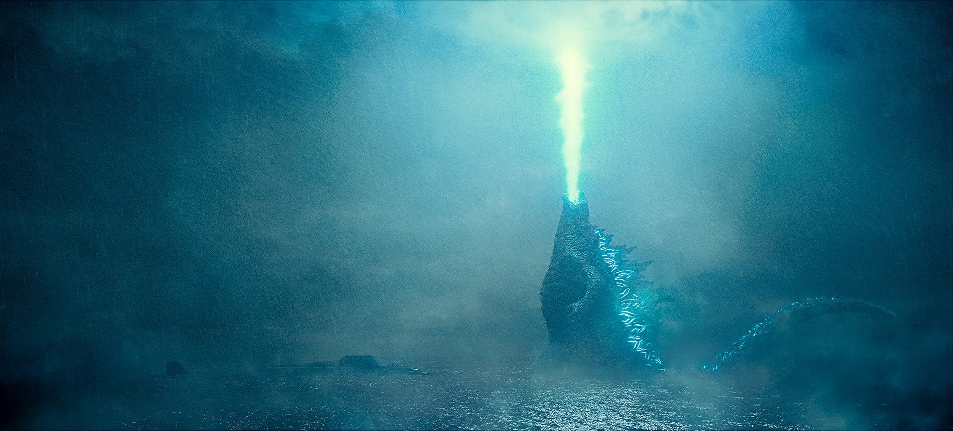 Godzilla rises from the depths and unleashes his atomic breath to claim his crown as King of the Monsters