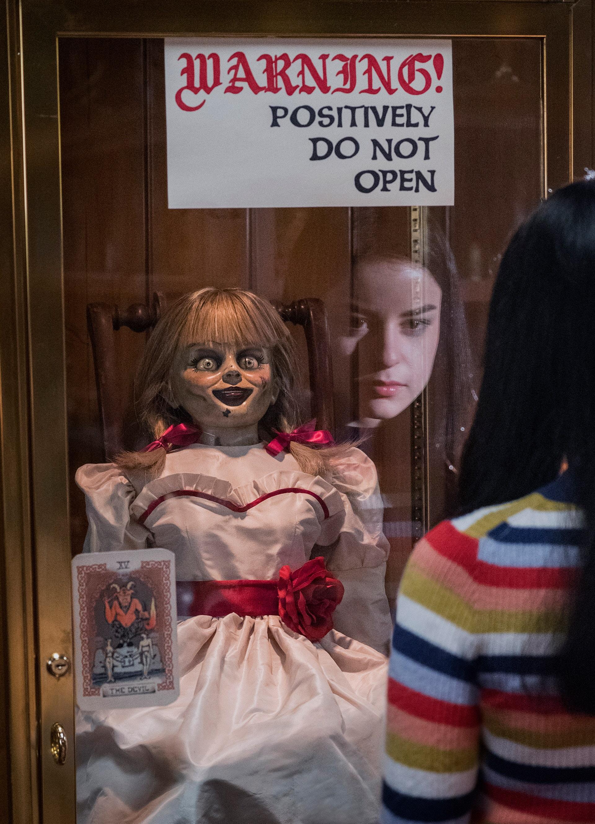 (L-R) The Annabelle doll and KATIE SARIFE as Daniela