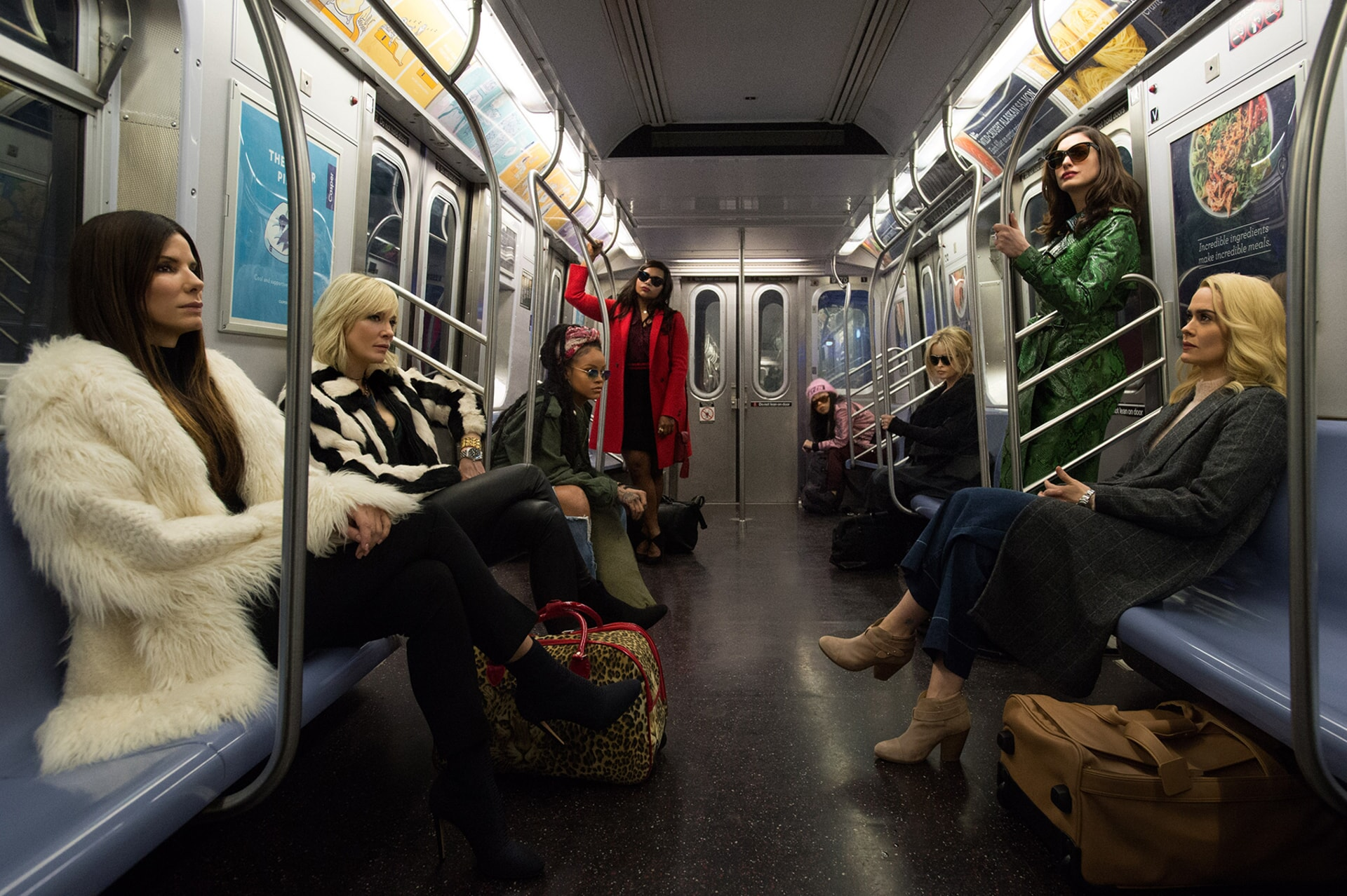 "first look at ""Ocean's 8"" from one of New York City's most iconic locales: the subway. In Summer 2018, the tide will turn as (L-r) Debbie Ocean (SANDRA BULLOCK) attempts to pull off the heist of the century at New York City's star-studded annual Met Gala. Her first stop is to assemble the perfect crew: Lou (CATE BLANCHETT); Nine Ball (RIHANNA); Amita (MINDY KALING); Constance (AWKWAFINA); Rose (HELENA BONHAM CARTER); Daphne Kluger (ANNE HATHAWAY); and Tammy (SARAH PAULSON)."