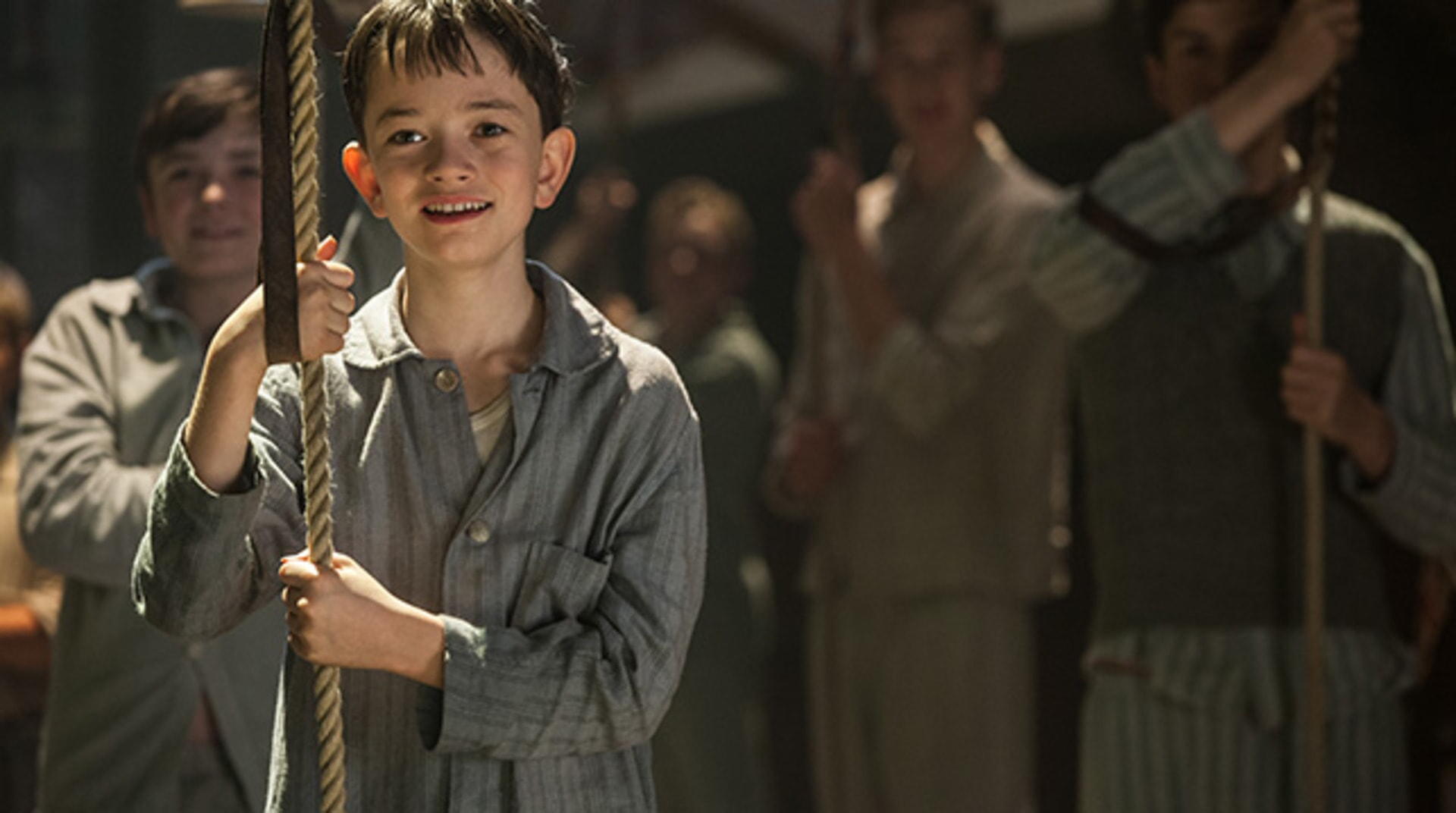 """LEWIS MACDOUGALL as Nibs in Warner Bros. Pictures' and RatPac-Dune Entertainment's action adventure """"PAN,"""" a Warner Bros. Pictures release."""