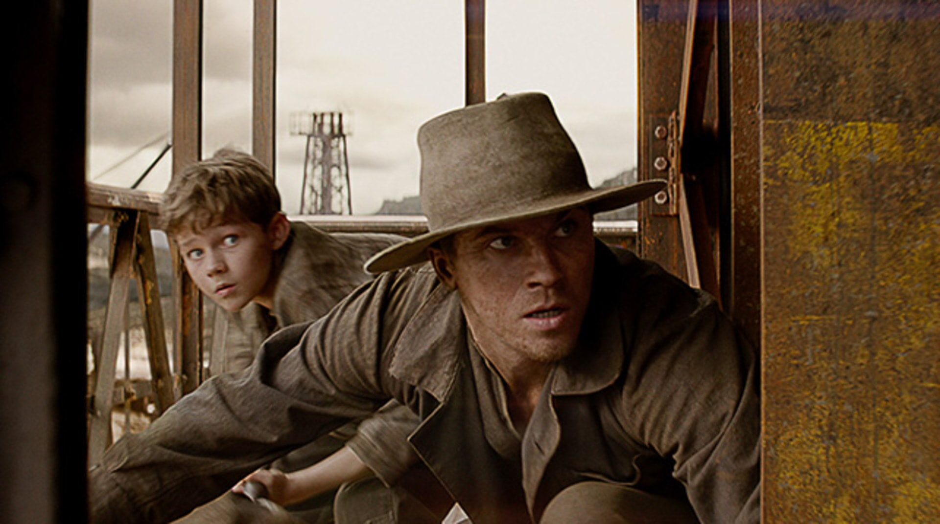 """LEVI MILLER as Peter and GARRETT HEDLUND as Hook in Warner Bros. Pictures' and RatPac-Dune Entertainment's action adventure """"PAN,"""" a Warner Bros. Pictures release."""