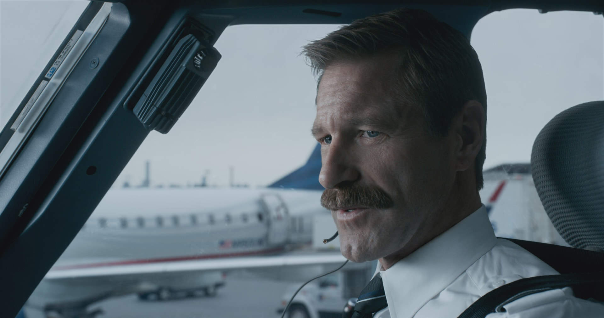 "AARON ECKHART as Jeff Skiles in Warner Bros. Pictures' and Village Roadshow Pictures' drama ""SULLY,"" a Warner Bros. Pictures release."
