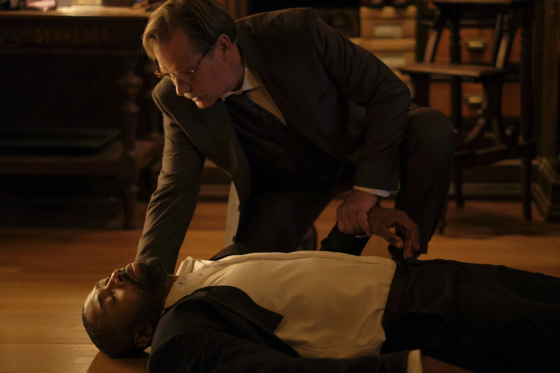 """Cress Williams lying on the floor while attended to by James Remar in episode """"Dark Matter of My Brain"""""""