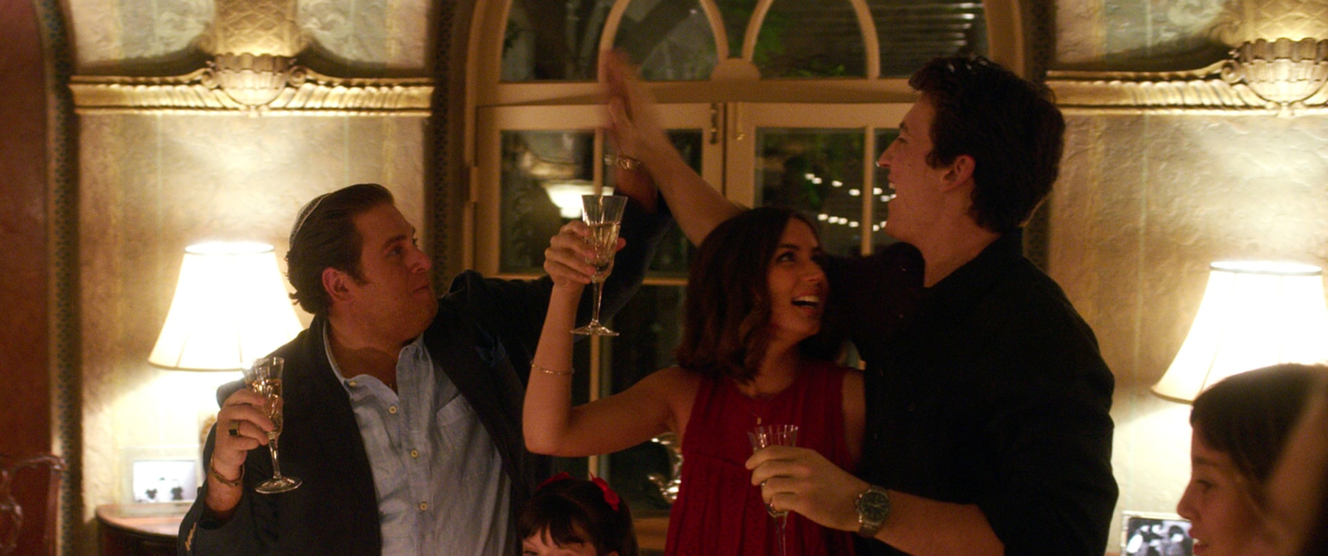 """JONAH HILL as Efraim, ANA DE ARMAS as Iz and MILES TELLER as David in Warner Bros. Pictures' comedic drama (based on true events) """"WAR DOGS,"""" a Warner Bros. Pictures release."""