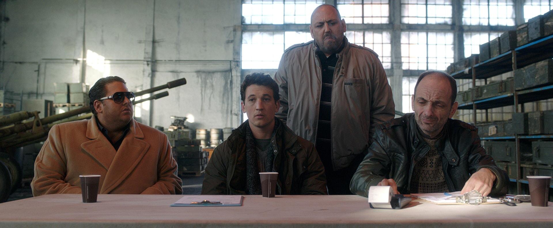"JONAH HILL as Efraim, MILES TELLER as David, JB BLANC as Bashkim and GABRIEL SPAHIU as Enver in Warner Bros. Pictures' comedic drama (based on true events) ""WAR DOGS,"" a Warner Bros. Pictures release."