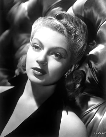 """Close publicity shot of Lana Turner. Photographed in late 1940 for her MGM film """"Ziegfeld Girl"""" (1941)."""