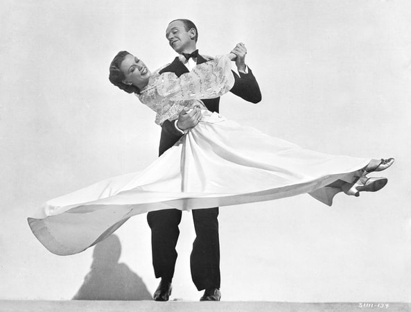 Full publicity shot of Fred Astaire as Johnny Brett and Eleanor Powell as Clare Bennett, dancing.