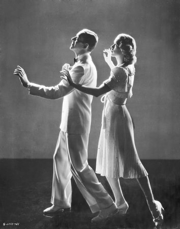 Full publicity shot of Fred Astaire as Johnny Brett and Eleanor Powell as Clare Bennett, in shadows dancing.