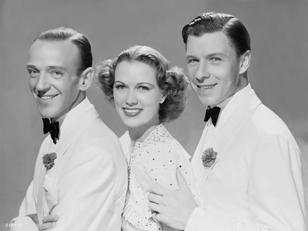 Medium publicity shot of Fred Astaire as Johnny Brett, Eleanor Powell as Clare Bennett and George Murphy as King Shaw.