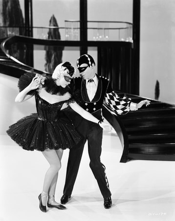 "Full shot of Eleanor Powell as Clare Bennett, wearing mask, and Fred Astaire as Johnny Brett during musical number ""I Concentrate On You."""