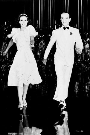 Full shot of Fred Astaire as Johnny Brett and Eleanor Powell as Clare Bennett dancing during musical number.