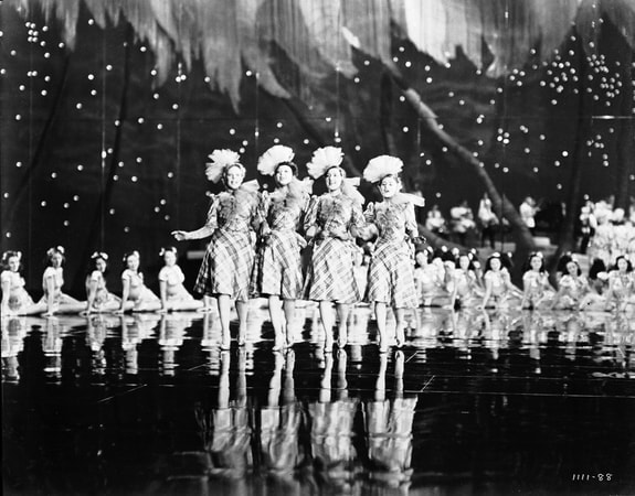 "Wide shot of chorus girls during musical number ""Begine The Beguine."""