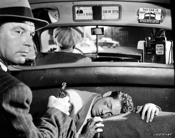 Medium shot of James Craig as George Garsell, wearing hat and holding gun/pistol, in backseat of car/cab with injured Farley Granger as Joe Norson; with Harry Bellaver as Larry Giff driving.