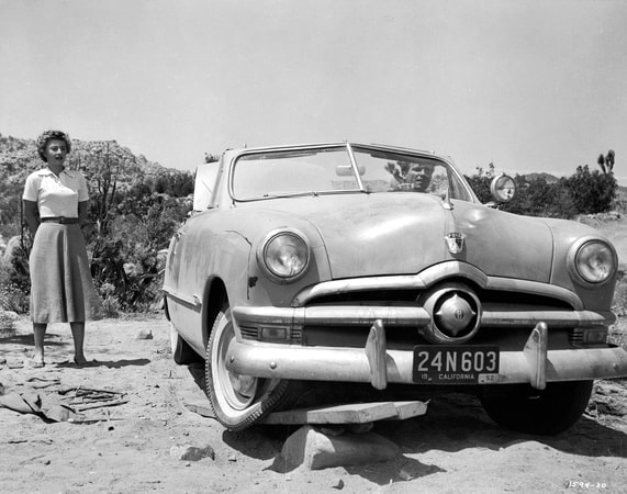Barbara Stanwyck in convertible