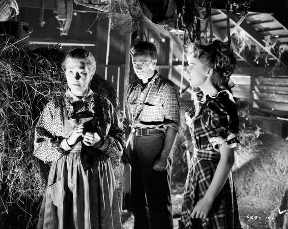 Medium shot of Fay Bainter as Ellie Saul, Dane Clark as Barry Burnette and Ida Lupino as Libby Saul.