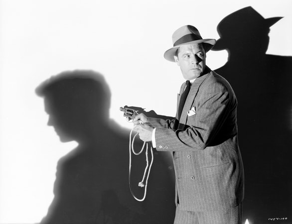 Medium publicity shot of James Craig as George Garsell, wearing hat, holding gun/pistol and rope.