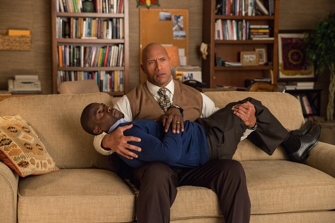 KEVIN HART as Calvin and sitting in DWAYNE JOHNSON as Bob's lap