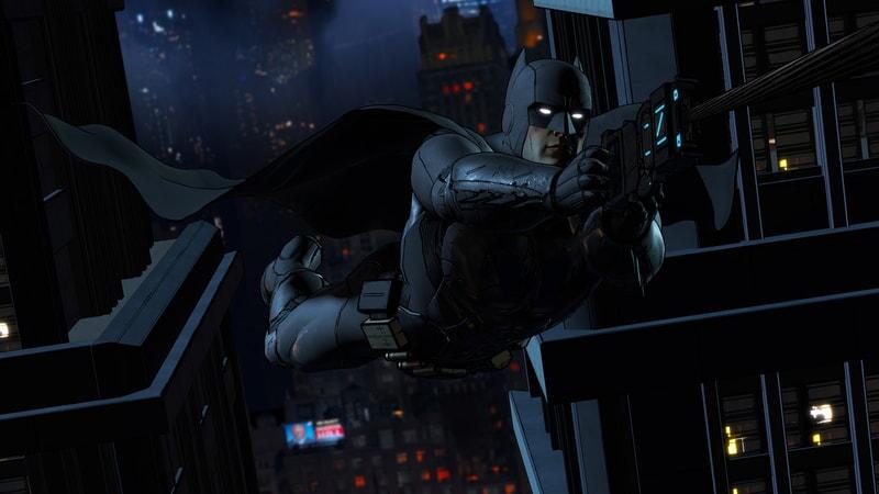 Batman using his grappling gun swinging from building