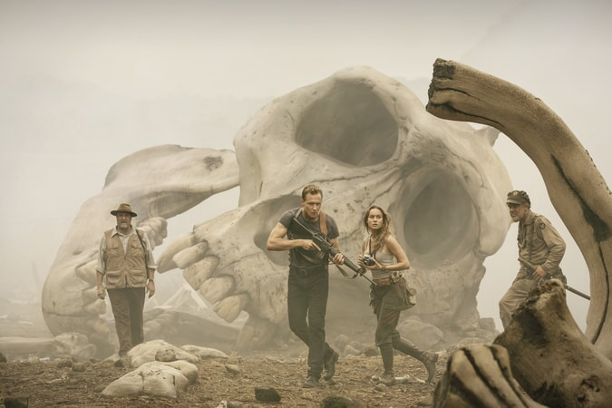 "JOHN GOODMAN as Randa, TOM HIDDLESTON as Conrad, BRIE LARSON as Mason and JOHN C. REILLY as Marlow in Warner Bros. Pictures' and Legendary Pictures' action adventure ""KONG: SKULL ISLAND,"" a Warner Bros. Pictures release."