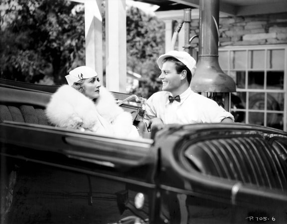Virginia Hammond as Mrs. S.T. Franklyn with hat and fur sitting in back seat of car next to Joel McCrea as Blacky Gorman with hat.