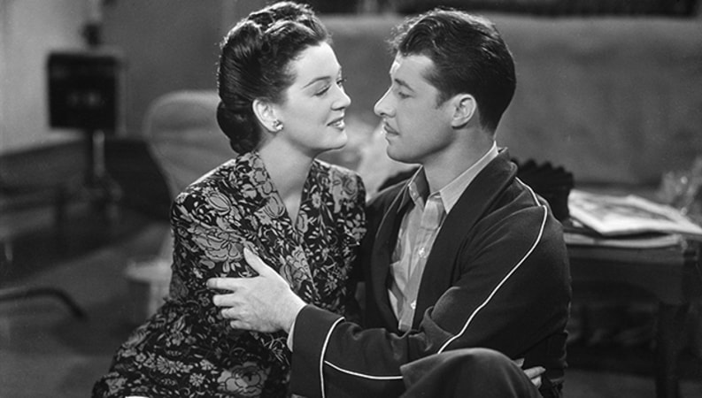 Kay Francis and Don Ameche in The Feminine Touch