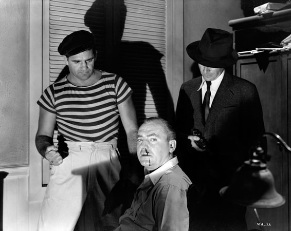 Sammy Stein (henchman), with Norbert Schill roughing up Pat O'Brien with very vibrant shadows behind them.