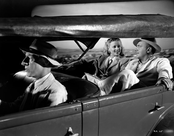Percy Kilbride as Pop driving Pat O'Brien as Dan Hammer and Anne Jeffreys as Maxine Manning, who are seated in the back.