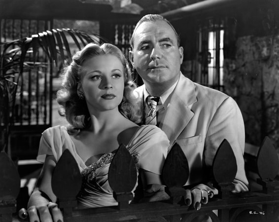 Pat O'Brien as Dan Hammer and Anne Jeffreys as Maxine Manning standing together in Riff-Raff