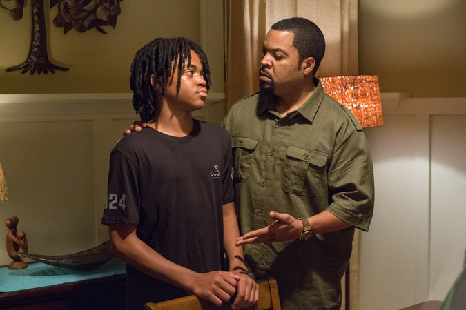 MICHAEL RAINEY JR. as Jalen and ICE CUBE as Calvin in Barbershop: The Next Cut