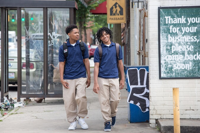 DIALLO THOMPSON as Kenny and MICHAEL RAINEY JR. as Jalen in Barbershop: The Next Cut
