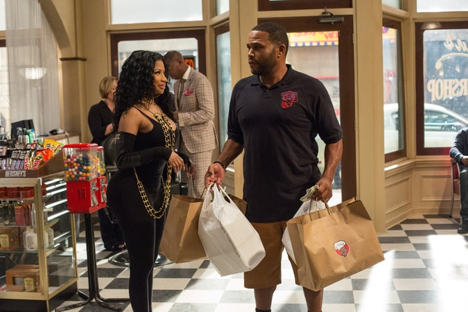 NICKI MINAJ as Draya and ANTHONY ANDERSON as J.D. in Barbershop: The Next Cut