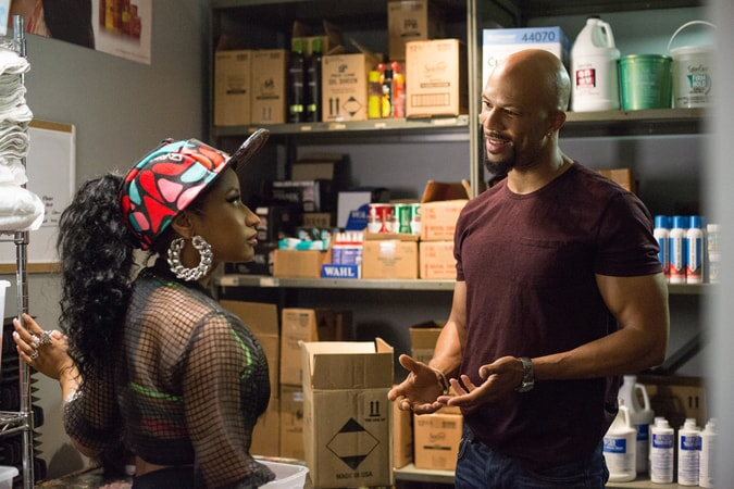 NICKI MINAJ as Draya and COMMON as Rashad in Barbershop: The Next Cut