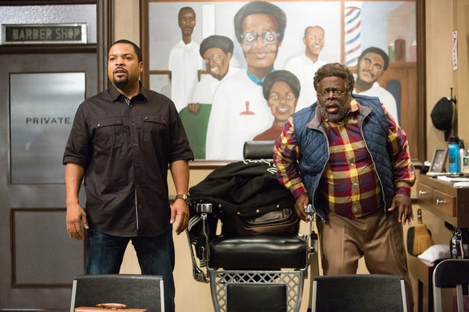 ICE CUBE as Calvin and CEDRIC THE ENTERTAINER as Eddie in Barbershop: The Next Cut