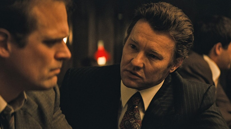 "DAVID HARBOUR as John Morris and JOEL EDGERTON as John Connolly in the drama ""BLACK MASS."""