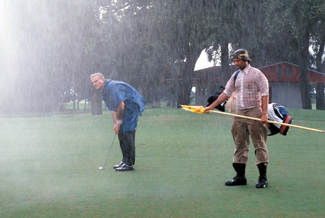 henry wilcoxin as the bishop and bill murray as carl spackler in caddyshack