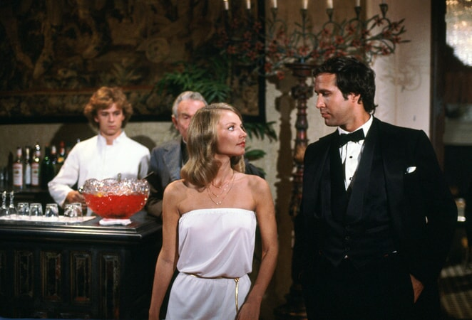 cindy morgan as lacey underall and chevy chase as ty webb in caddyshack