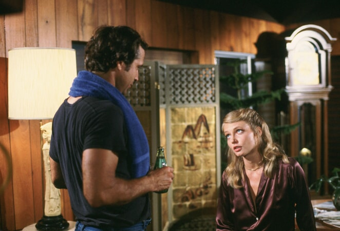 chevy chase as ty webb and cindy morgan as lacey underall in caddyshack