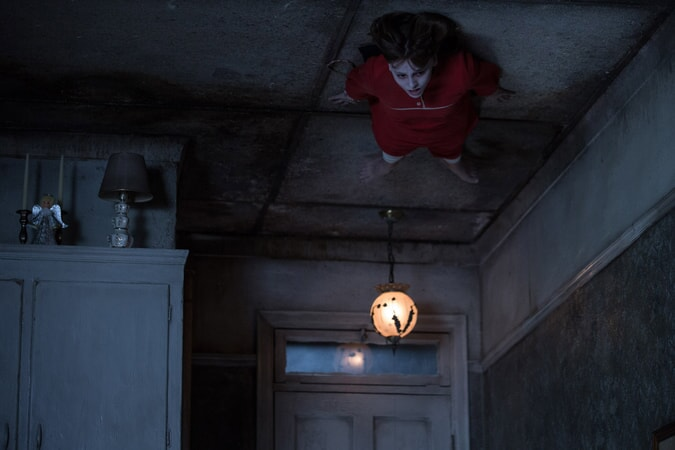 MADISON WOLFE as Janet Hodgson stuck to the ceiling in red night gown
