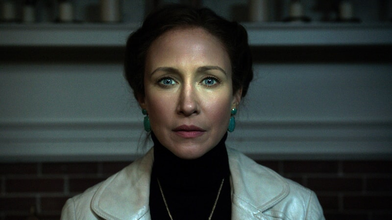 VERA FARMIGA as Lorraine Warren with hair pulled back and eyes illuminated