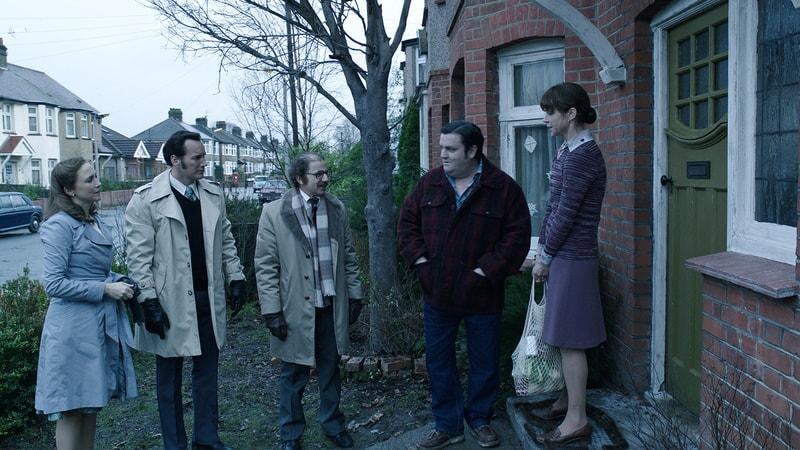 ERA FARMIGA as Lorraine Warren, PATRICK WILSON as Ed Warren, SIMON McBURNEY as Maurice Grosse, SIMON DELANEY as Vic Nottingham and FRANCES O'CONNOR as Peggy Hodgson meeting outdoors