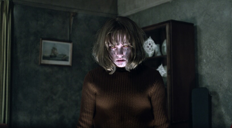 MADISON WOLFE as Janet Hodgson seemingly possessed