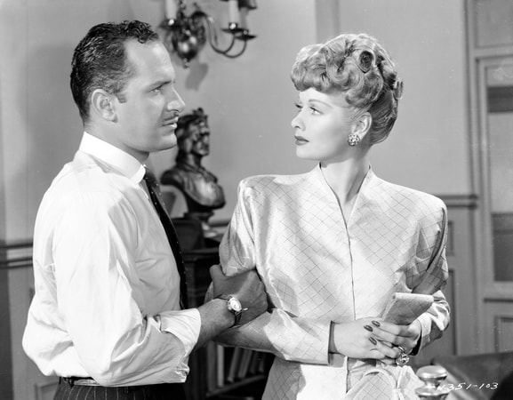 Keenan Wynn as Warren Haggerty standing holding the arm of Lucille Ball as Gladys Benton.