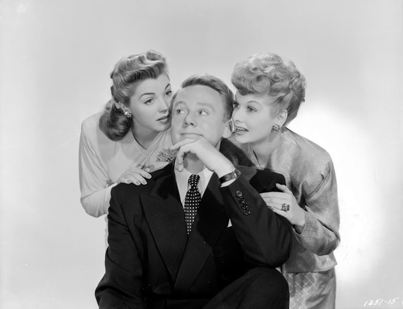 Esther Williams as Connnie Allenbury leaning on the shoulder of Van Johnson as Bill Chandler with one hand touching face and Lucille Ball as Gladys Benton leaning on the other shoulder.