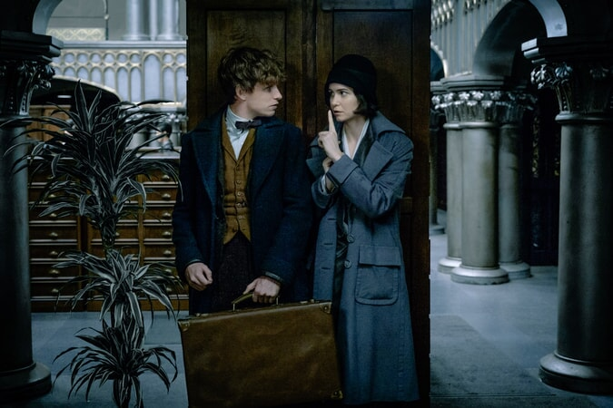 "EDDIE REDMAYNE as Newt Scamander and KATHERINE WATERSTON as Tina in Warner Bros. Pictures' fantasy adventure ""FANTASTIC BEASTS AND WHERE TO FIND THEM,"" a Warner Bros. Pictures release."