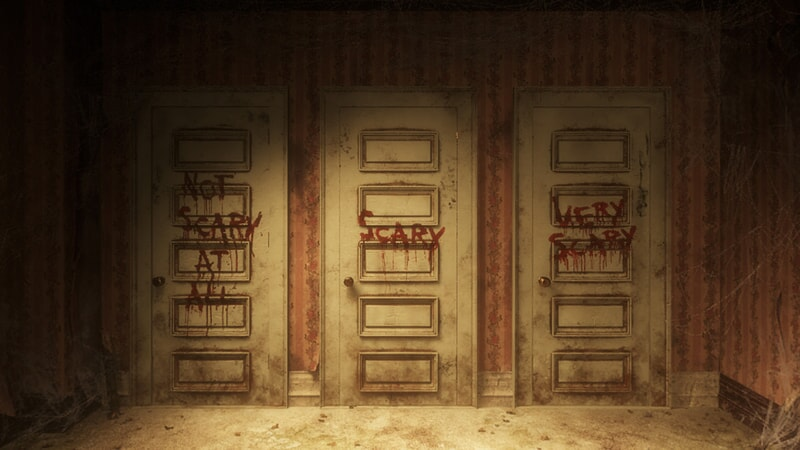 "Three doors to choose from with ""Not Scary at All"", ""Scary"" and ""Very Scary"" scrawled in blood"