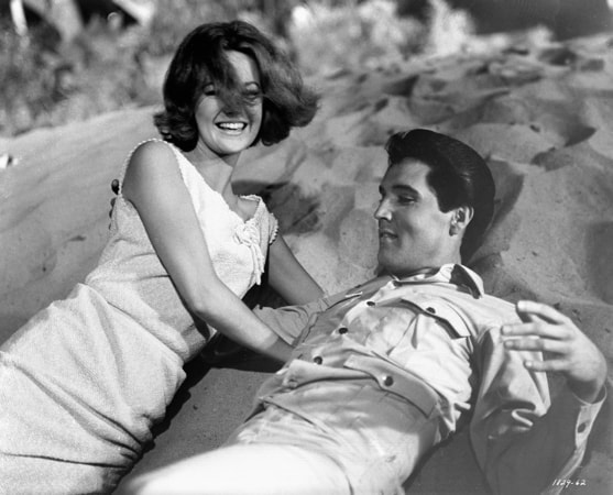 "shelley fabares and elvis presley laughing on the beach during the musical number ""Do the Clam"" in Girl Happy"