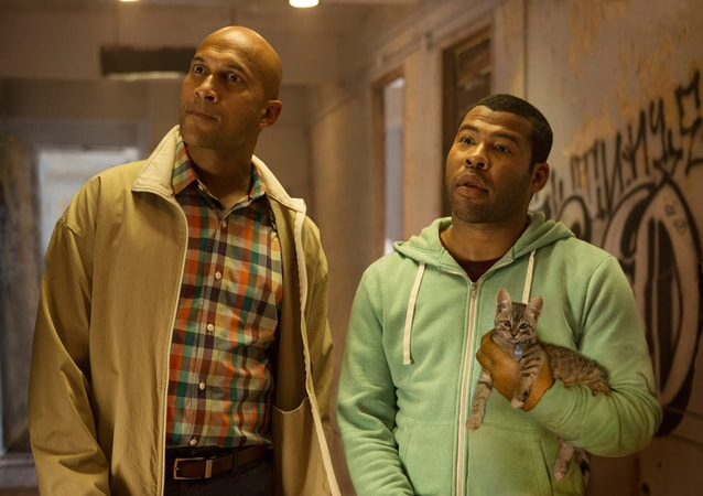 KEEGAN-MICHAEL KEY as Clarence Goobril and JORDAN PEELE as Rell Williams holding Keanu the kitten