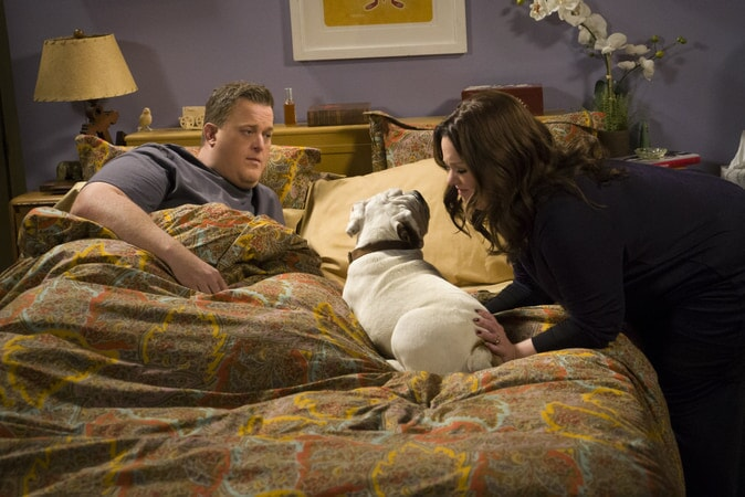 Mike & Molly in bed with a dog (Season 6)